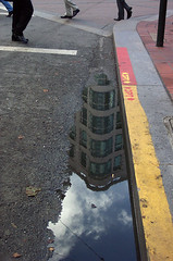 gutter glory (fotogail) Tags: sanfrancisco california street red urban storm reflection feet wet water rain yellow clouds gutter fotogail sfchronicle96hours partialpeople your300pre2006favesthanks ilobsterit