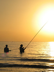 Fishing at sunset (Lil [Kristen Elsby]) Tags: ocean sunset sea bali orange sun beach topf25 water silhouette yellow indonesia fishing asia southeastasia fishermen horizon tropical getty itsongselection1 mirrorsofsociety topv3333 gettyimages lovina itsongcanong5 itsongmirrorssoutheastasia gettyimagesonflickr