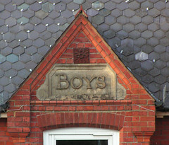 boys entrance sign, school building