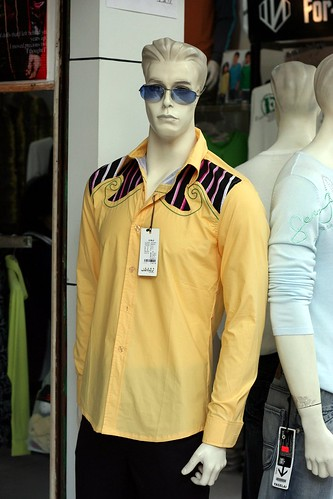 You find some rather interesting mannequins in the Yichang clothes market. Here, young Elvis is trying for a comeback.