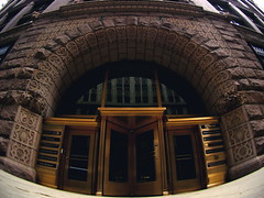 main entrance, the rookery (Frank, Jr.) Tags: door city windows chicago brick window stone architecture skyscraper illinois downtown doors loop c decoration landmark ornament massive chicagoloop ornamental brass imposing rookery decorated tftf chicagopublicradio criticismwelcome