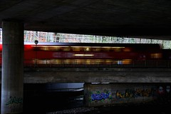 concrete, colored and red blurred (Dreamer7112) Tags: bridge red motion 20d lamp train river concrete graffiti schweiz switzerland europe colours suisse suiza stones canon20d zurich blurred canoneos20d zürich svizzera zuerich eos20d underthebridge inmotion zurigo motionblurred everydaylifeinswitzerland sihltalbahn