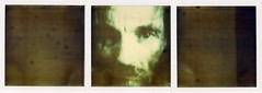 homeless guy on the tv (flybutter) Tags: abstract polaroid interestingness triptych onestep 779 flybutter crappyexpiredfilm tvpublicserviceannouncement heatdamagedinthetoasteroven destroidaroid