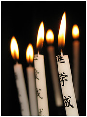 Prayer candles (Lil [Kristen Elsby]) Tags: light japan catchycolors temple japanese asia candles candle prayer buddhism topv5555 flame kanji getty topf150 kinkakuji gettyimages eastasia  gettyimagesonflickr