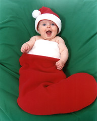Baby in Santa Hat and Christmas Stocking (BarelyFitz) Tags: kids christmas stocking baby red green santa hat sock smile cute family december gift present holiday surprise xmas cold lauren notbyme santahat christmasstocking