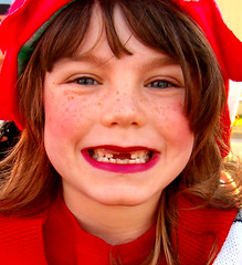 2frontteeth (Covalent Chick) Tags: christmas red portrait cute topf25 girl smile face catchycolors happy kid texas child teeth unfound parade 25 freckles girlscout missingteeth 2frontteeth twofrontteeth favekids