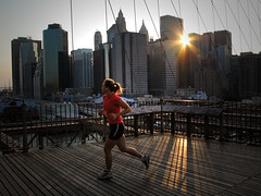 Brooklyn Bridge jogger (Lil [Kristen Elsby]) Tags: nyc newyorkcity bridge sun ny newyork lines skyline brooklyn downtown cityscape dusk manhattan running run wires brooklynbridge getty editorial itsongselection1 jogging topf100 jogger starburst gettyimages reportage flickrvision topv7777 perfectingladolcevita itsongcanong5 privateworlds gettyimagesonflickr flickreditorial