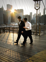 Hurrying across Brooklyn Bridge (Lil [Kristen Elsby]) Tags: nyc bridge sun newyork skyline downtown cityscape dusk walk manhattan wires brooklynbridge jewish editorial mirrorsofsociety topv4444 topf100 starburst hasidic itsonginvite itsongcanong5 itsongmirrorsnorthamerica hasidicjew gettycurators gettycurator forgettycurators forflickreditorial flickreditorial forflickrvision