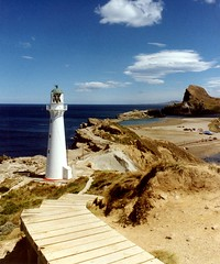 Castle Point Lighthouse (Brenda Anderson) Tags: ocean newzealand lighthouse water topv111 geotagged rocks pacific nz gettyimages castlepoint wairarapa scannedprint curiouskiwi intop40set utatafeature imagekind brendaanderson utata:memberpageskin=ba geo:lat=40899655 geo:lon=176231636 utata:memberpagelayout=test utata:title=show utata:project=v3test3 utata:project=upfaves nz101castlepoint curiouskiwi:posted=2004