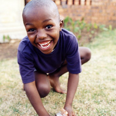 Soweto boy (Lil [Kristen Elsby]) Tags: poverty africa boy portrait smile square southafrica happy child african laugh topf100 johannesburg joburg soweto topv6666