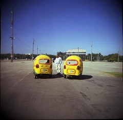 coco-taxis (dogseat) Tags: blue man cute topf25 yellow stand holga twins couple coconut taxi pair havana nuts talk center double ishootfilm taxis converse round discussion habana coconuts speak qba between cocotaxi fotologbook flickys conceptscreativity frontandcenter doublethepleasure