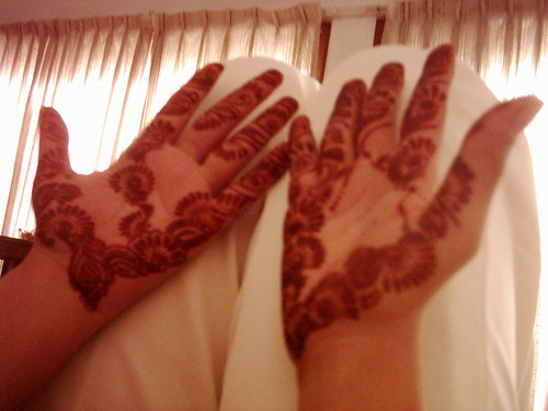 mehndi patterned hands height=375