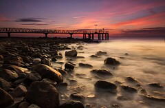 The firsts lights (Anto Camacho) Tags: xilxes valencia valenciancommunity rocks pier mediterraneansea sea landscape seascape waterscape castelln comunitatvalenciana bigstopper sunshine