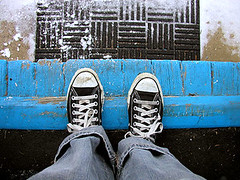 shoegazing, with snow (massdistraction) Tags: door blue selfportrait snow feet home me self snowflakes pants mat jeans doorway converse denim welcome lookingdown doormat chucks sharyn shoegazing blackchucks