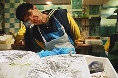 fishmonger (lomokev) Tags: portrait fish man paris male nikon fishmonger 35ti pescados nikon35ti replaced deletetag posted:to=tumblr