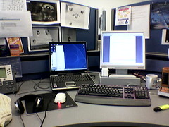 My Workspace (Mark) Tags: workspace desk work laptop cameraphone tft monitor screen mouse headphones keyboard mug telephone workplace busy 6230 nokia phone blue grey gray