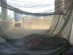 sleeping on a roof in mopti - mosquito nets