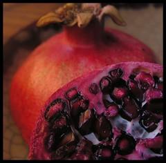 Temptation (hurleygurley) Tags: red macro fruit interestingness pomegranate seeds explore r rgb tam persephone hades hg hurleygurley juicey rgb1 tamxx utatared elisabethfeldman faveset