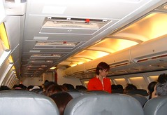 Walking the Aisle (Danburg Murmur) Tags: airline stewardess flightattendant airasia boeing737 seatback overheadbin