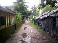 Puddle Lane (jackol) Tags: 2004 india kolkata lane calcutta road