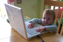 Starting Her Out Young (Tracey Gessner) Tags: avagessner computer ava gessner laptop macintosh mac ibook