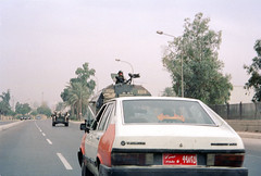 Iraq - Baghdad - 16-33 (Jeff_Werner) Tags: iraq backpacking travel middleeast highway street baghdad war soldiers taxi humvee gun
