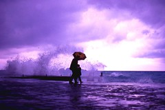 Walking (Gianni Dominici) Tags: flickrzen wow topv111 topf25 interestingness italia italy rain umbrella people positano sunset travel minolta analagic scanner blue snapshot topv333 topf50 topv555