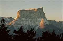 Mont Aiguille (Ron Layters) Tags: sunset france mountains nature geotagged interestingness slide explore valley transparency agfa vercors rescanned tablemountain smrgsbord ctprecisa agfachrome mountainsalps elevation20002500m flickfly ronlayters slidefilmthenscanned geo:lat=448444 geo:lon=554843 montaiguille betterthangood summitmontaiguille altitude2085m highestpositioninexplore63onfridayoctober312008