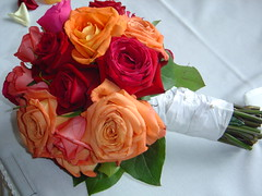 Bride's Bouquet (2) (smcgee) Tags: pink flowers wedding red roses orange groom bride bouquet weddings twincities weddingphotographer weddingdetails weddingideas weddingphotography lauramark may142005 samsif