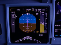 This modern airliner cockpit is how a PFD should display altitude information - click for a better view.