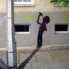 shadow of a road lamp (6) (Antonia Schulz) Tags: street city shadow urban streetart berlin lamp cutout town calle paint paste cité ciudad stadt urbana various creatures rue ville affiche urbain détournement cityghost strase écriteau