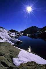A star in the sky (Guillaume Bertocchi) Tags: sky sun mountain lake reflection searchthebest quality oneyear interestingness8 i500 specland