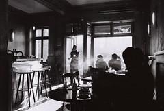 KostBar (abbilder) Tags: berlin film bar analog blackwhite cafe nikon smoke xp2 analogue flair prenzlauerberg rauch twop scheibe kostbar barhocker 10faves thresen nikonstunninggallery sr319 203528d abbilder wwwabbildercom