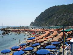 Blue umbrella, red umbrella (Andrei Z) Tags: 2003 travel beach mediterranean tour july monterosso contiki s45