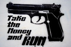 spraypaint stencil of a gun with the words take the money and run