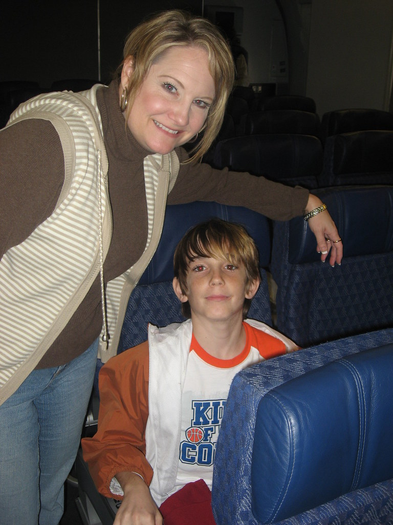 Deborah and Christian check out their seats on Flight 61 to Tokyo