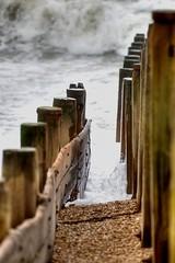 w a v e ~ t u n n e l (zerajera) Tags: wood sea sky clouds tide shingle haylingisland pebbles hampshire rush solent d200 groyne sandypoint zerajera woodengroyne