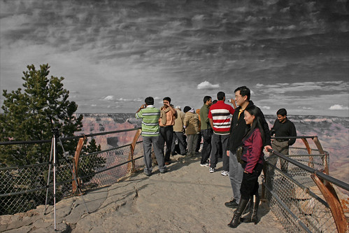 The Grand Canyon and its Tourists - Couple taking photo of themselves at the Grand Canyon