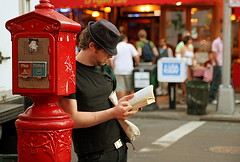IMG_7625 (artcphoto) Tags: street city nyc red urban newyork reading manhattan greenwichvillage bleekerst 1on1peoplephotooftheday anawesomeshot superbmasterpiece anaawesomshot 1on1peoplephotoofthedaymay2007