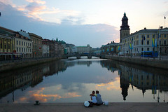 Couple (georaz) Tags: street city bridge blue light boy sunset shadow red two sky orange woman cloud white man streets reflection building bus tower love church water girl yellow loving clouds stairs buildings göteborg mirror evening canal election hug day arm cathedral pentax cloudy sweet sweden dusk flag gothenburg swedish surface row flags romance pale reflect mirrored sverige bags dim channel waterway svensk reflects clouded k100d