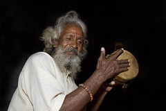 Sadhu Singing Religious Songs (Bhajans) in a Street at Amritsar.India (Captain Suresh Sharma) Tags: street old travel portrait people music india holiday man heritage tourism face saint hair beard asian skinny outside happy person grey healthy hands asia peace play singing display outdoor robe percussion indian traditional faith prayer religion pray joy poor longhair culture belief happiness monk east holy health instrument wise sacred yogi ritual priest aged turban thin punjab musicalinstrument custom spiritual ethnic hindu hinduism eastern enjoying pilgrimage amritsar humble pilgrim sadhu punjabi ascetic holyman austere greyhair devout pious godly madhyapradesh seniorcitizen saintly spiritualism jhansi panjab devoution dvoutee