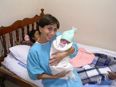 Comadrona traditional midwife with baby volunteering international cooperation Quetzaltenango Guatemala Latin America