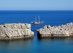 sailing boat (esther**) Tags: blue sea sky boat bravo rocks ship greece wisdom rhodes interestingness105 abigfave