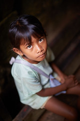 Little Cambodian girl, Angkor, Cambodia (Alex_Saurel) Tags: day orientation planamericain portraiture gaze vertical eyes imagetype planmoyen body people fullframe time photoreportage stockcategories photoreport hair scans photojournalism photospecs travel yeux portray face portrait reportage asia cambodge pleinformat sony50mmf14sal50f14
