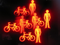 Biker gang (squacco) Tags: camera light red orange black blur trafficlights men night bikes bicycles plastic attachment stop crap motor
