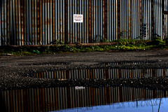private blues (SmackNally) Tags: blue reflection fence puddle notquite privateproperty gunnahavetogoback