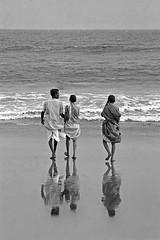 India, Orissa , Puri (luca marella) Tags: india orissa puri beach reflex people sea reflection praying sand waves marellaluca marella bianco e nero bn black white bw pb photo film analog
