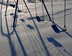 Silence (Lynn Fagerlie) Tags: winter snow cold abandoned playground children bravo alone quiet peace shadows sad empty swings swing lynn forgotten silence serenity swingset serene lonely deserted fagerlie p1f1 aplusphoto