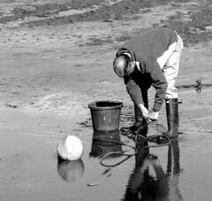 boatman at low tide (aly1j) Tags: beach dorset boatman mending