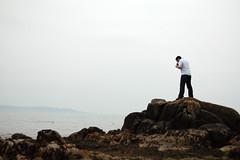 Peeping Tom (Rob Weychert) Tags: dublin rocks irishsea jasonsantamaria